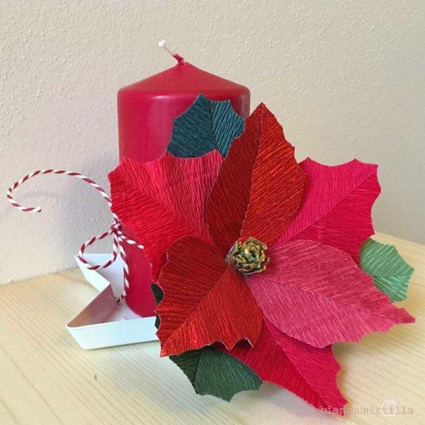 Stella di Natale con candela, fiori di carta idee regalo